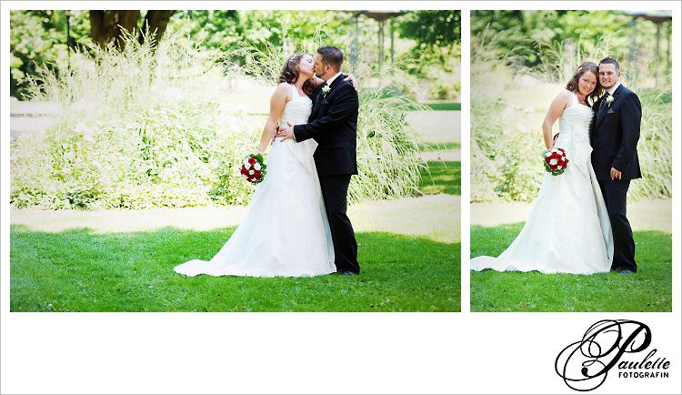 Paulette Fotografin fotografiert wie sich das Hochzeitspaar küsst beim Brautpaarshooting im Schlossgarten Fulda.
