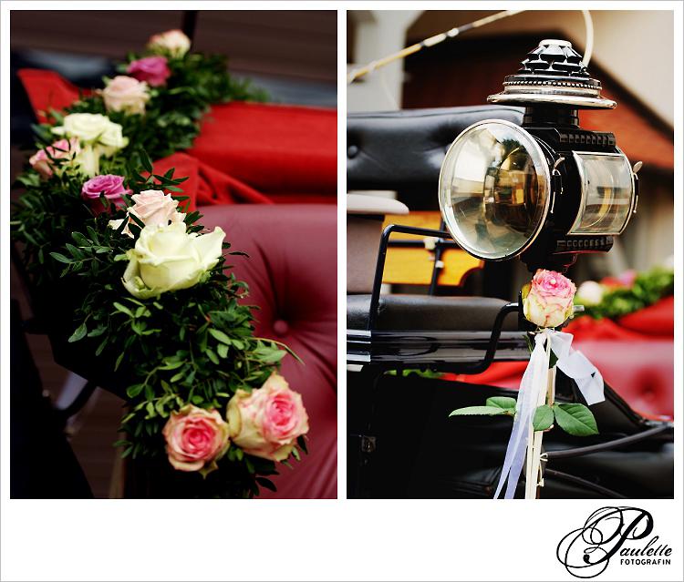 Die Hochzeitskutsche steht bereit im Reiterhof Wiegand in Fulda Bronnzell geschmückt mit rosa Rosen.