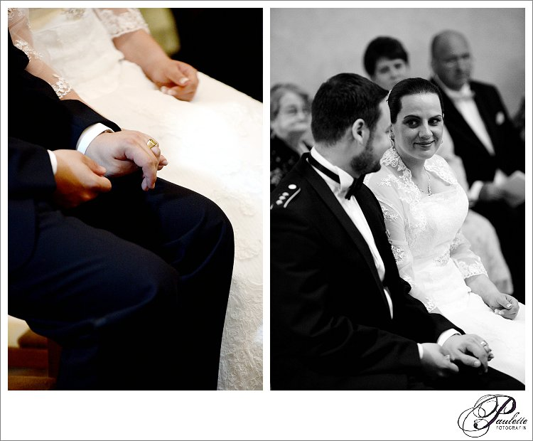 Braut ist gerührt mit Tränen und ihr Ehemann hält ihre Hand bei der kirchlichen Trauung, der Bräutigam trägt Unfirom.